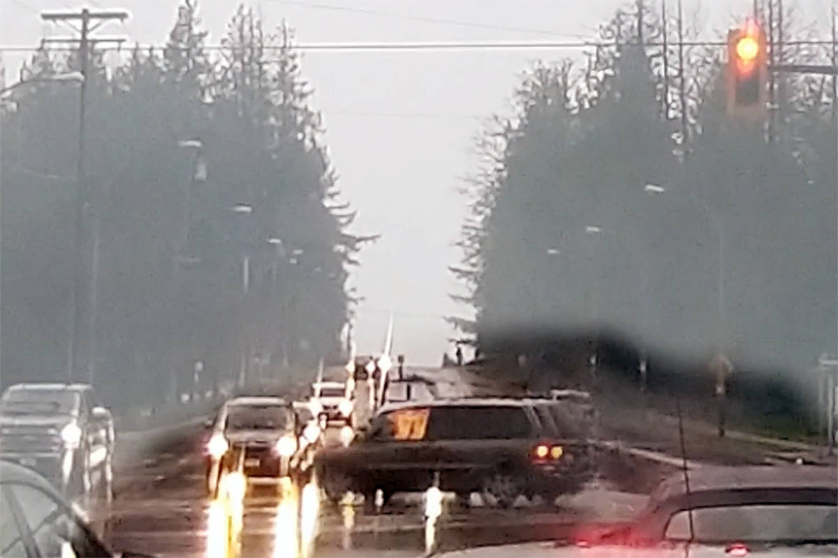 A dashcam caught the moment when a burning van went through the intersection of 88 Avenue and 216 Street in Langley's Walnut Grove neighbourhood on Tuesday, Nov. 17, 2020 around 2:30 p.m. (special to Langley Advance Times)