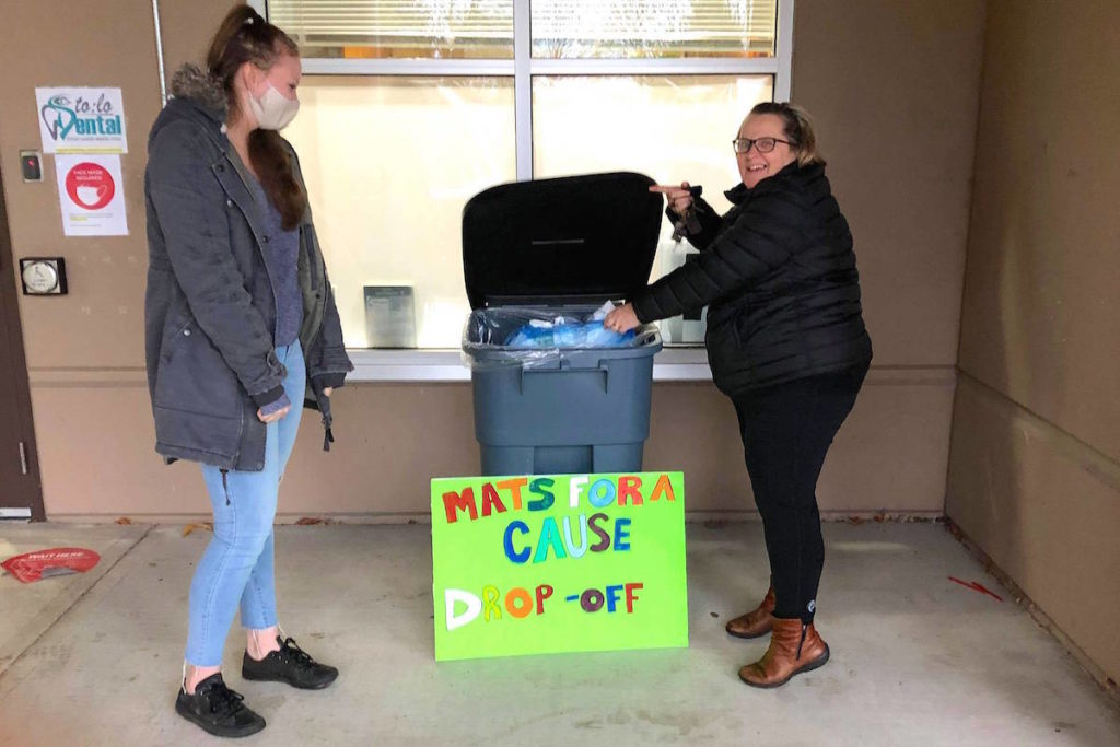 Alexis Stollings watches as Sharon Reeder donates plastic bags to the 'Mats for a Cause Chilliwack' effort to weave sleeping mats for the homeless in Chilliwack. (Darren Stollings photo)