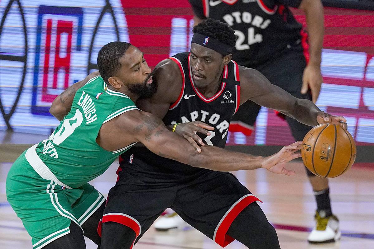 Toronto Raptors forward Pascal Siakam (43) drives on Boston Celtics guard Kemba Walker (8) during the second half of an NBA conference semifinal playoff basketball game Wednesday, Sept. 9, 2020, in Lake Buena Vista, Fla. (AP Photo/Mark J. Terrill)