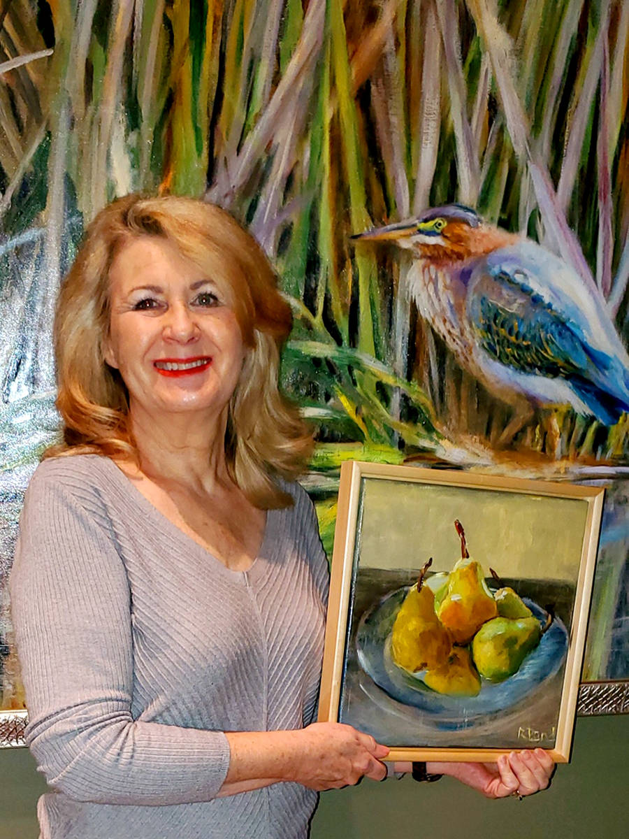 Robin Bandenieks, a member of the Fort Langley Artist Group, shows off her art. (FLAG/Special to the Star)