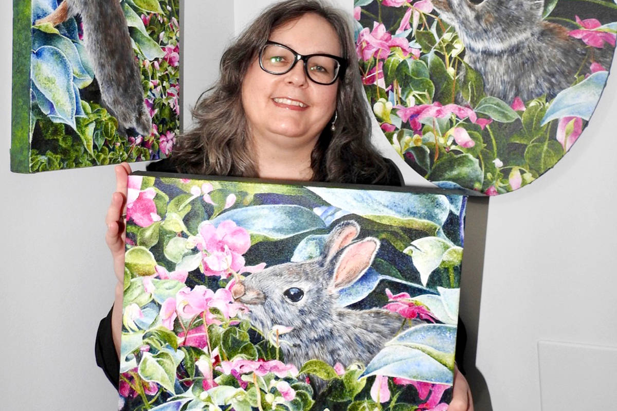 Caroline Ashley, a member of the Fort Langley Artist Group, shows off her art. (FLAG/Special to the Star)