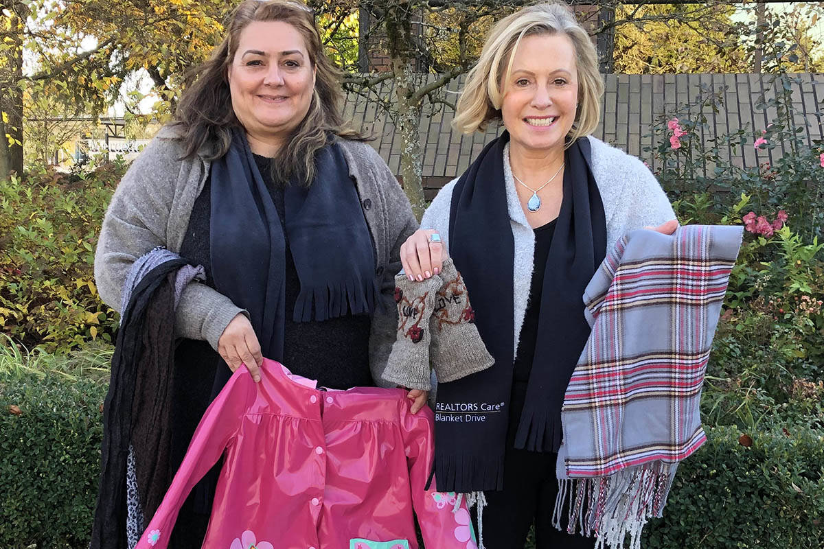 Yvonne Wysocki and Julia Greene collected donations last year for the Realtors Care blanket drive. This year the fundraising event has moved online due to concerns around the spread of COVID-19. (Langley Advance Times file)