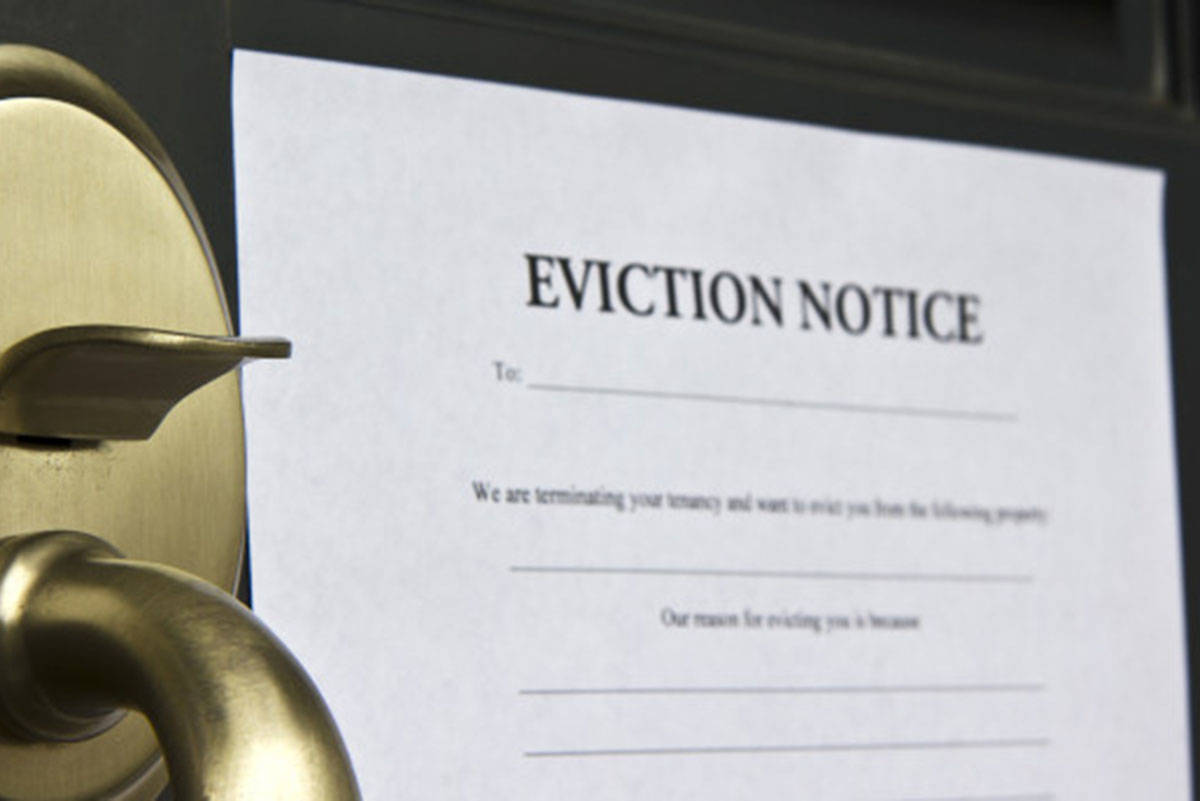 Eviction notice letter pasted on front door of a house (B.C. Tenants photo)