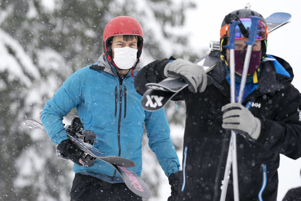A skier wears a face mask to help prevent the spread of COVID-19 during the first day of the downhill ski season at Cypress Mountain in West Vancouver, B.C. Friday, November 13, 2020. Recreational travel has been suspended across B.C. until at least Dec. 7, 2020. THE CANADIAN PRESS