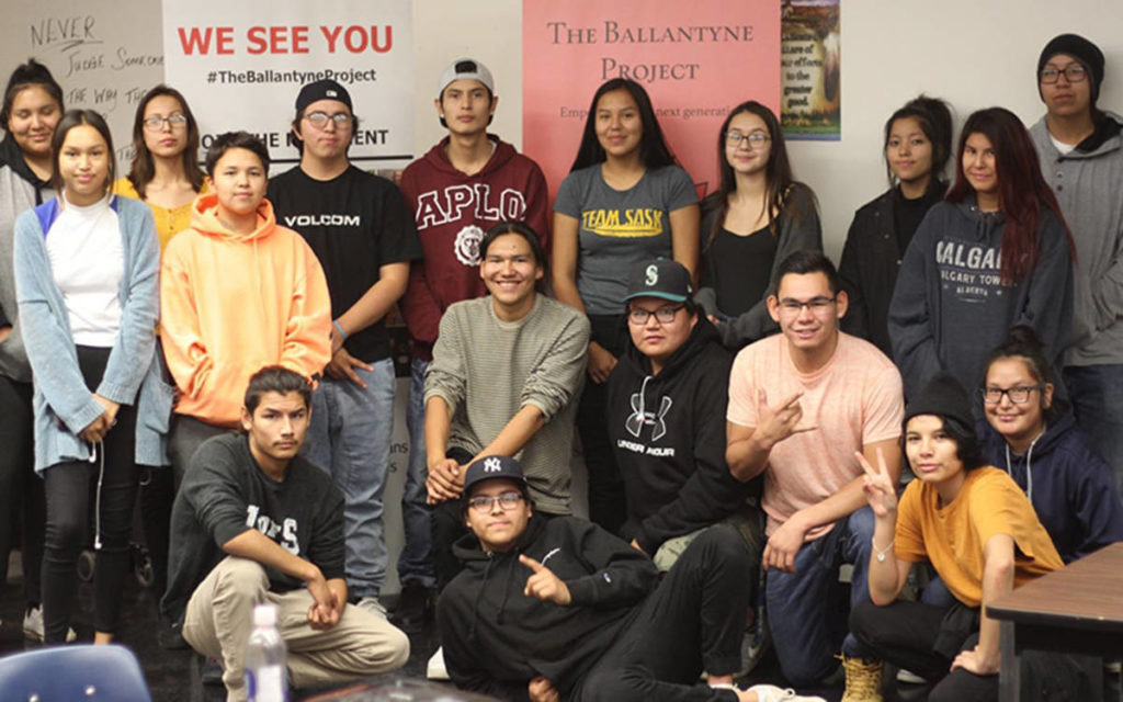 Dwight Ballantyne poses with young members of the George Gordon First Nation in Saskatchewan. (Special to The News)