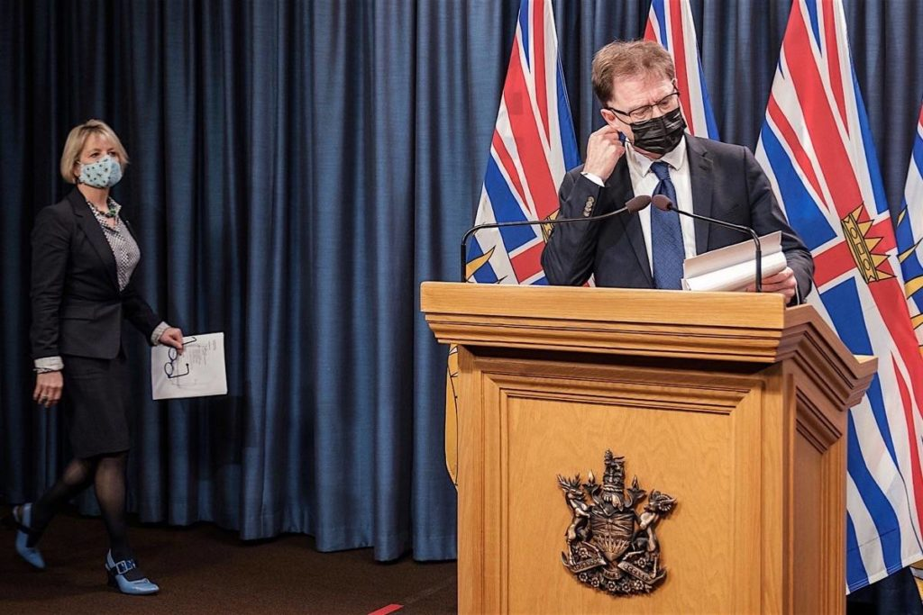 B.C. Health Minister Adrian Dix and provincial health officer Dr. Bonnie Henry announce province-wide travel and other restrictions at the B.C. legislature, Nov. 19, 2020. (B.C. government)
