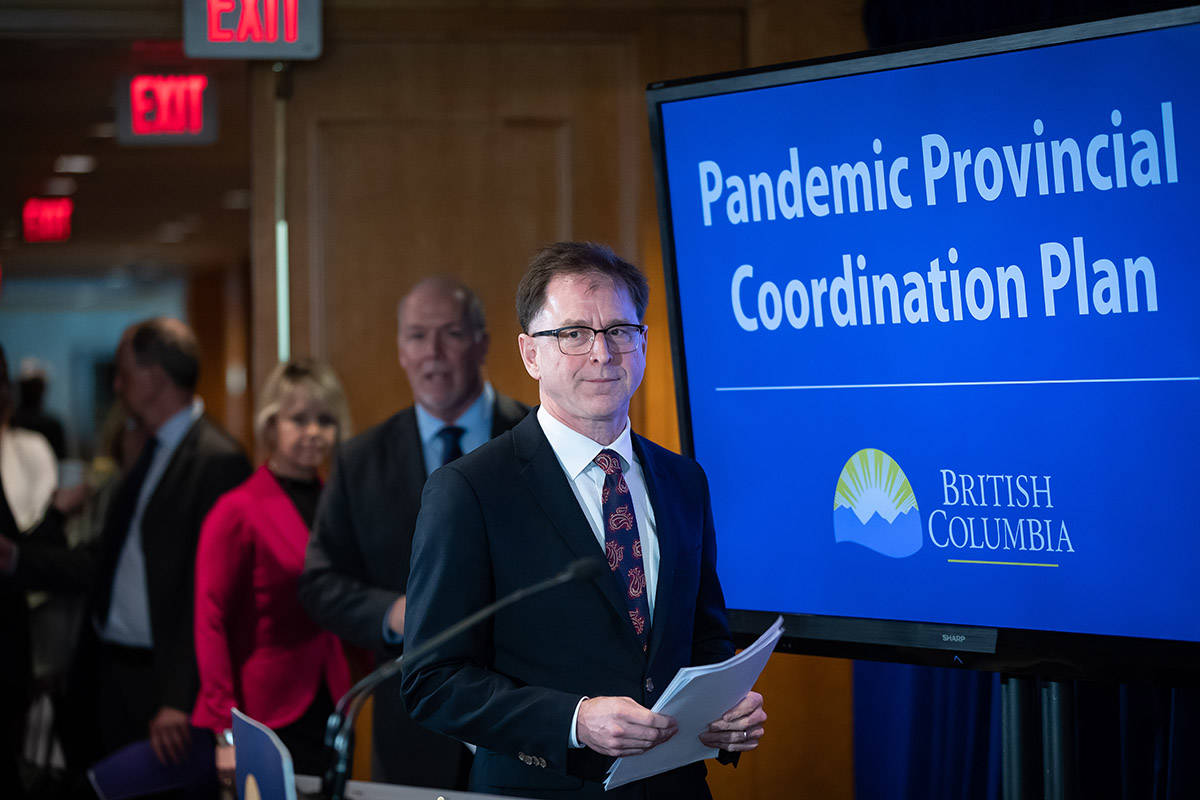 Health Minister Adrian Dix, front, B.C. Premier John Horgan and provincial health officer Dr. Bonnie Henry arrive for a news conference about the provincial response to the coronavirus, in Vancouver, B.C., Friday, March 6, 2020. THE CANADIAN PRESS/Darryl Dyck