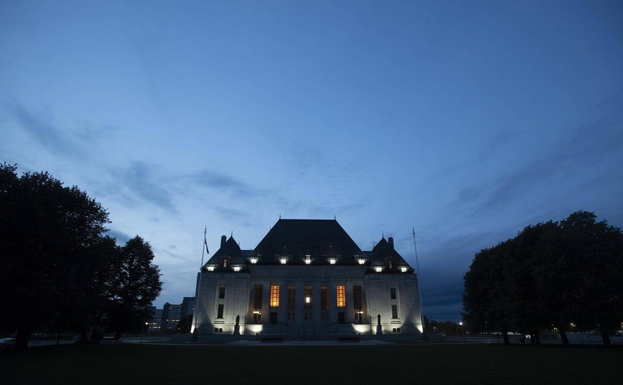 The Supreme Court of Canada is seen at sunset in Ottawa, Tuesday Sept. 1, 2020. The Supreme Court of Canada has affirmed that Ontario's sex-offender registry regime violates the constitutional rights of people found not criminally responsible by reason of mental disorder. THE CANADIAN PRESS/Adrian Wyld