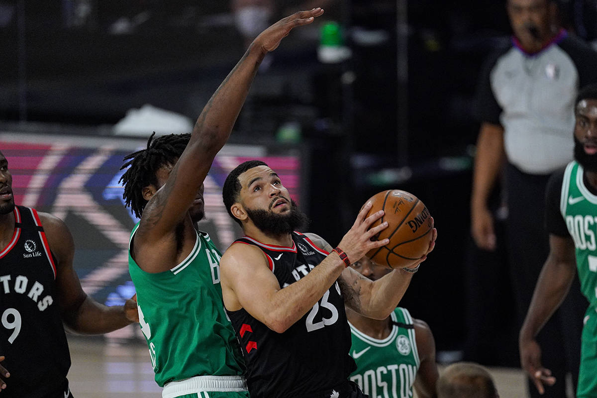 Toronto Raptors guard Fred VanVleet (23) shoots in front of Boston Celtics center Robert Williams III (44) during the first half of an NBA conference semifinal playoff basketball game Wednesday, Sept. 9, 2020, in Lake Buena Vista, Fla. (AP Photo/Mark J. Terrill)