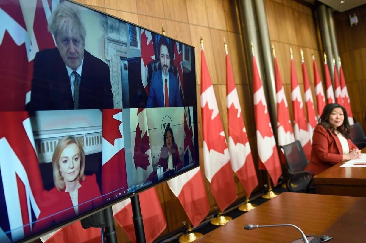 Minister of International Trade Mary Ng watches pre-recorded footage from an earlier videoconference that she participated in with Canadian Prime Minister Justin Trudeau, UK Prime Minister Boris Johnson and International Trade Secretary Liz Truss, during a news conference on the Canada-United Kingdom Trade Continuity Agreement in Ottawa, on Saturday, Nov. 21, 2020. THE CANADIAN PRESS/Justin Tang