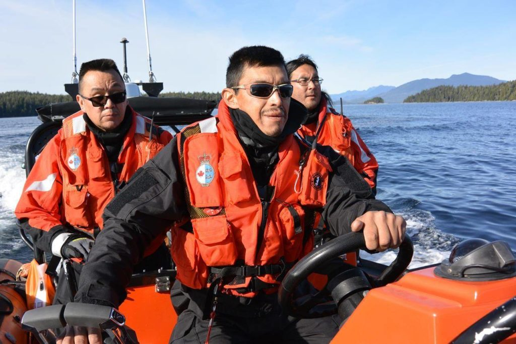 Numuch Keitlah, left, and Jake Thomas, centre, participate in a Coastal Nations search and rescue exercise off the coast of Vancouver Island in this undated handout photo. The recently operational Coastal Nations Coast Guard Auxiliary has more than 50 members from five Indigenous territories who are trained in marine search and rescue. They are on call day and night to respond to emergencies along some of B.C.'s most rugged and remote coastal areas. THE CANADIAN PRESS/HO, Jordan Wilson *MANDATORY CREDIT*