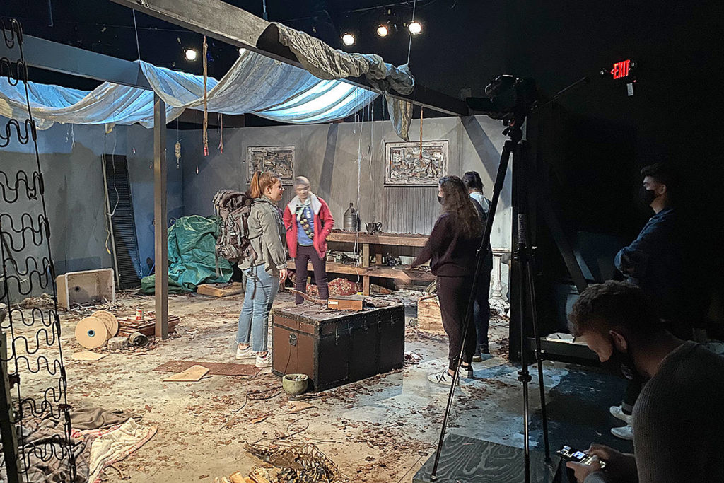 Actors rehearsing a scene in the upcoming TWU Theatre production of WROL (WIthout Rule of Law), which premieres on Dec. 1. (TWU/Special to Langley Advance Times)