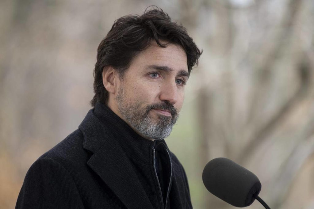 Prime Minister Justin Trudeau pauses after responding to a question about the holidays during a news conference outside Rideau Cottage in Ottawa, Friday, Nov. 20, 2020. THE CANADIAN PRESS/Adrian Wyld