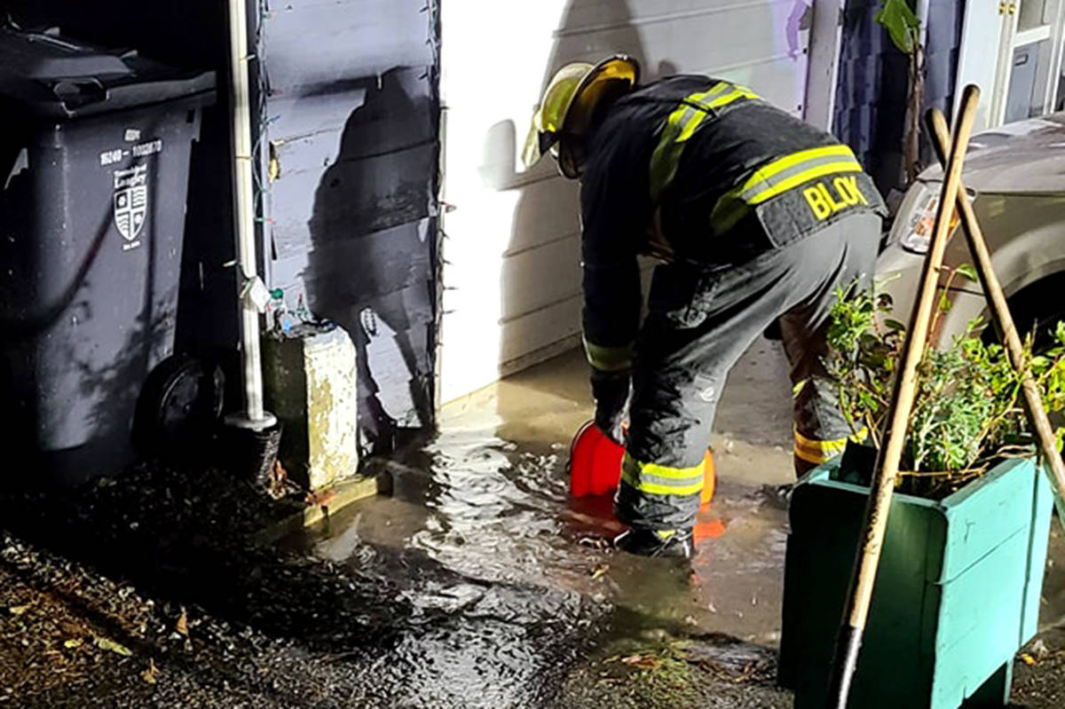 Fire crews dealt with a flooding home in Aldergrove last Tuesday night. (Liane Bisaillon/Special to The Star) Fire crews dealt with a flooding home in Aldergrove last Tuesday night. (Liane Bisaillon/Special to The Star)