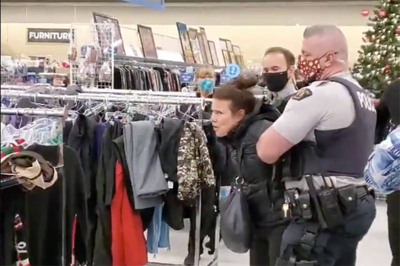 A woman being arrested at a Kelowna Value Village after refusing to wear a mask on Nov. 22.(@Jules50278750/Twitter)