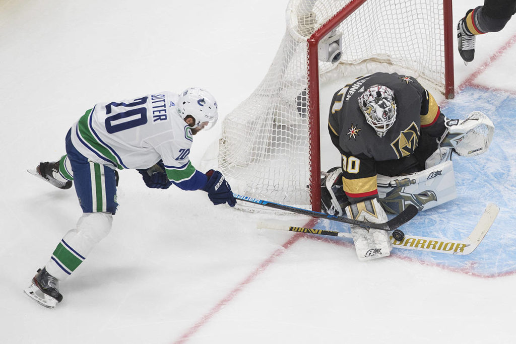 Vancouver Canucks' Brandon Sutter (20) is stopped by Vegas Golden Knights goalie Robin Lehner (90) during third period NHL Western Conference Stanley Cup playoff action in Edmonton on Friday, September 4, 2020. THE CANADIAN PRESS/Jason Franson