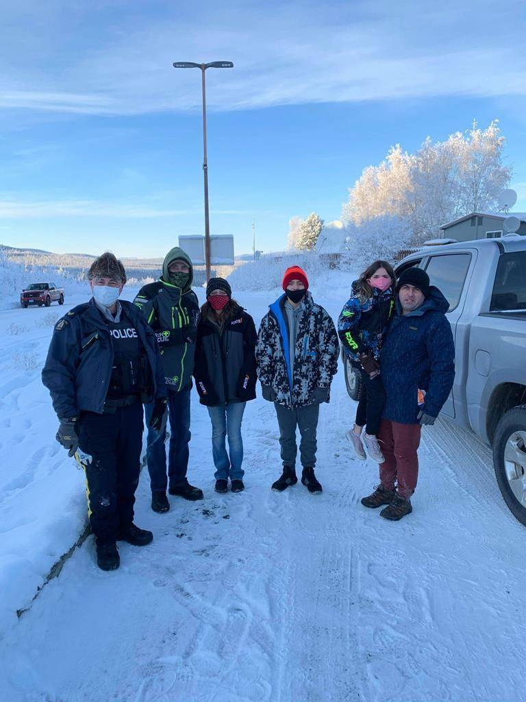 Beaver Creek RCMP Cpl. Robert Drapeau, left to right, Gary Bath, Lynn Marchessault, Payton Marchessault, Rebecca Marchessault and Tim Marchessault pose in this recent handout photo near the Canada-U.S. border crossing near Beaver Creek, Yukon. A family reunion trip for the woman from Georgia that left them stranded ended on a bright note when Bath drove them to the Alaskan border following an appeal for help. THE CANADIAN PRESS/HO, Gary Bath *MANDATORY CREDIT*