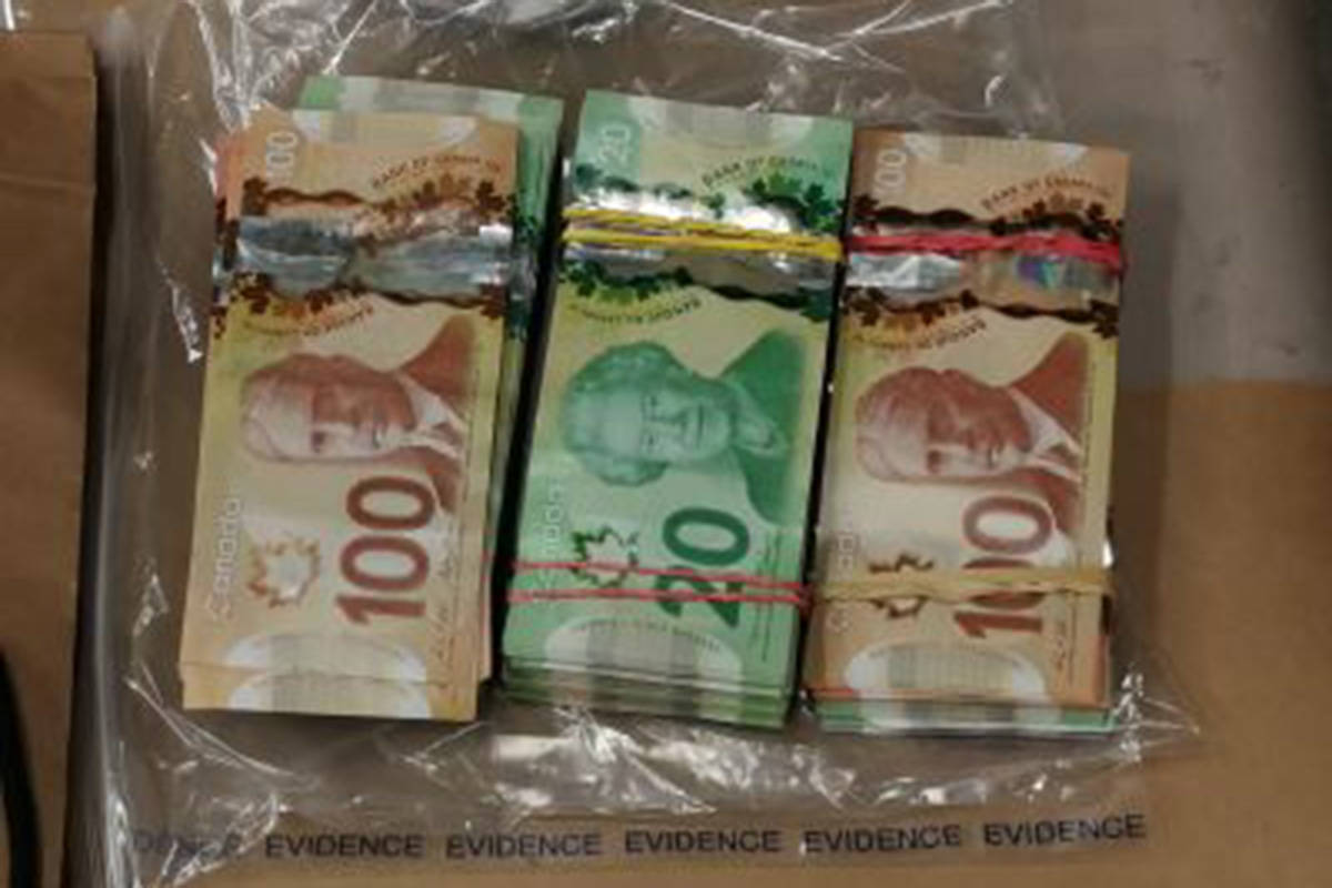 Suspected cocaine, opioids, cash, and ledgers were seized in raids on Nov. 21. (Langley RCMP/Special to the Langley Advance Times)