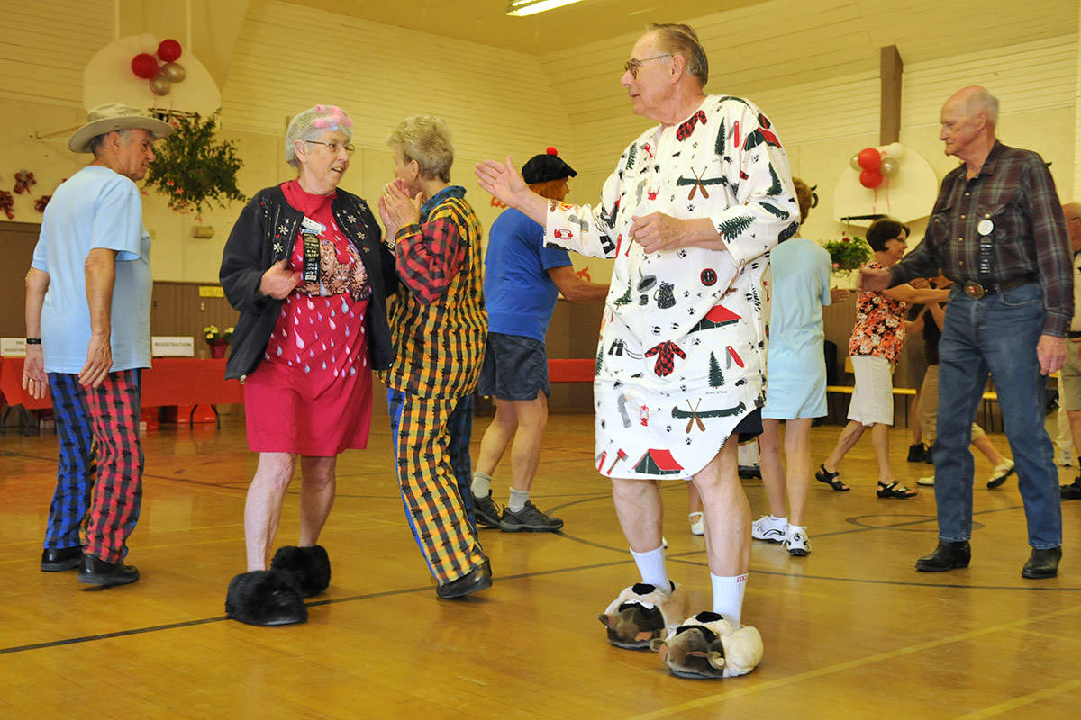 Mary Cox and Jack Plant dance in their pyjamas and slippers at the morning pyjama dance during the Rhythm Reelers' 25 Annual Rally in the Valley Square Dance Festival in Chilliwack on June 4, 2011. Sunday, Nov. 29, 2020 is Square Dancing Day. (Jenna Hauck/ Chilliwack Progress file)