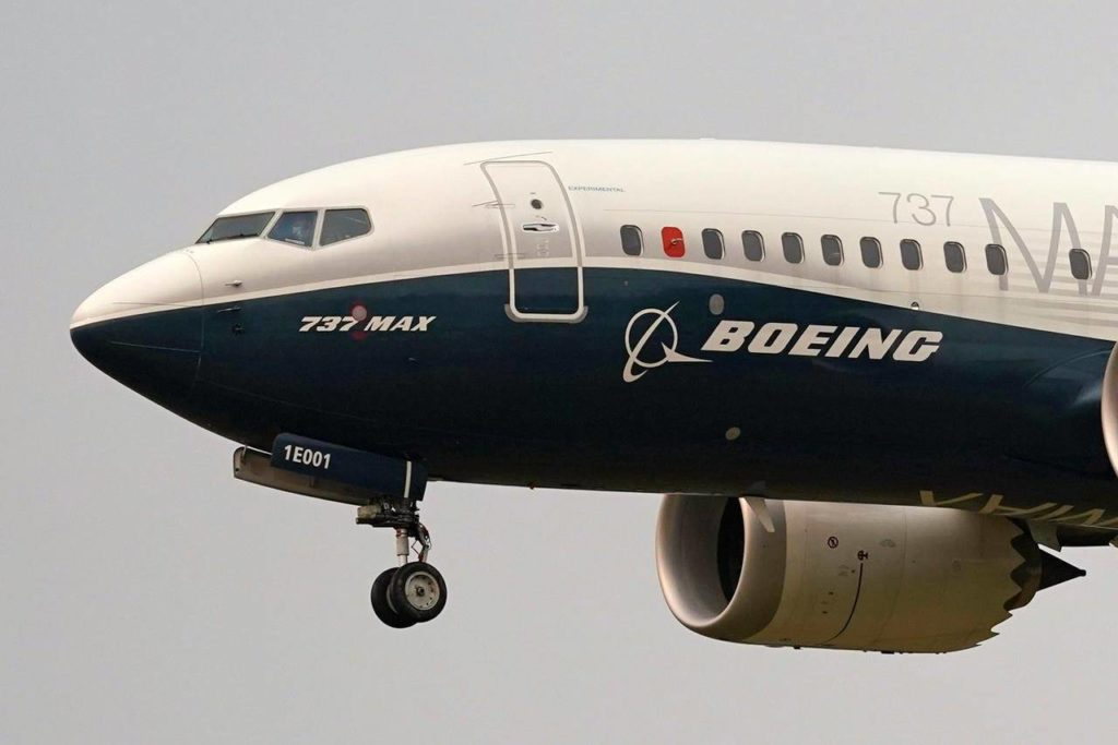 A Boeing 737 MAX jet, prepares to land at Boeing Field following a test flight Wednesday, Sept. 30, 2020, in Seattle. Families of Canadians killed in the Boeing 737 Max crash say the plane remains unsafe and should stay grounded, despite being cleared for takeoff by regulators in the United States. THE CANADIAN PRESS/AP, Elaine Thompson