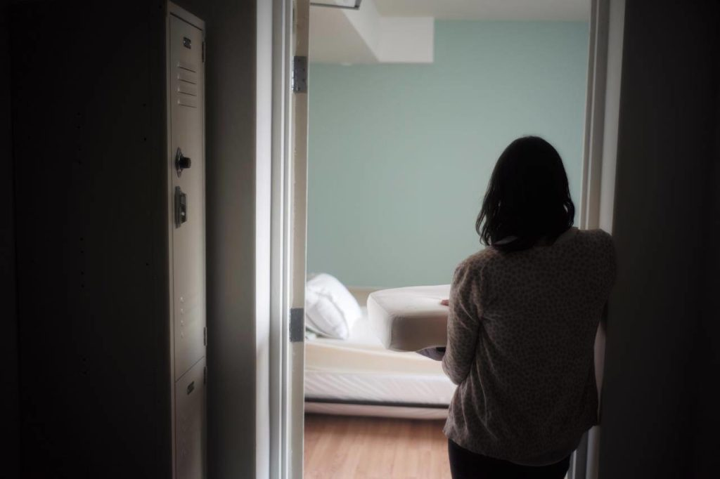 A staff member carries bedding in one of the suites at Toronto's Interval House, an emergency shelter for women in abusive situations, on Monday February 6, 2017. A new national survey by Women's Shelters Canada offers a glimpse into the experiences of front-line workers and women fleeing violence during the COVID-19 pandemic, with reports of clients facing more violence that is also increasing in severity. THE CANADIAN PRESS/Chris Young
