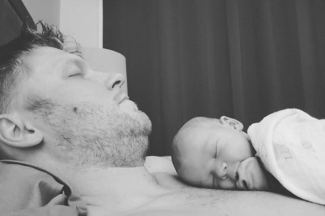Joel Goddard shown with his newborn baby. (GoFundMe campaign)