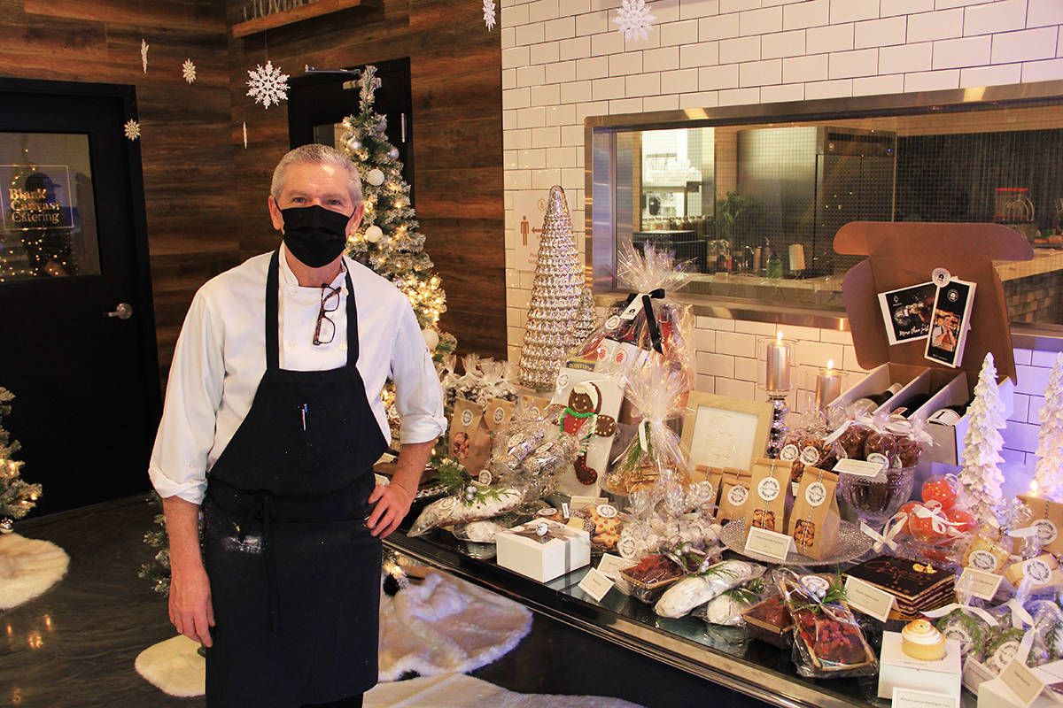 Pastry chef Eric Fernandez stands alongside some of his many creations at Popup Patisserie, a pop-up pastry shop on 176th Street that will be open until the end of December. (Photo: Malin Jordan)