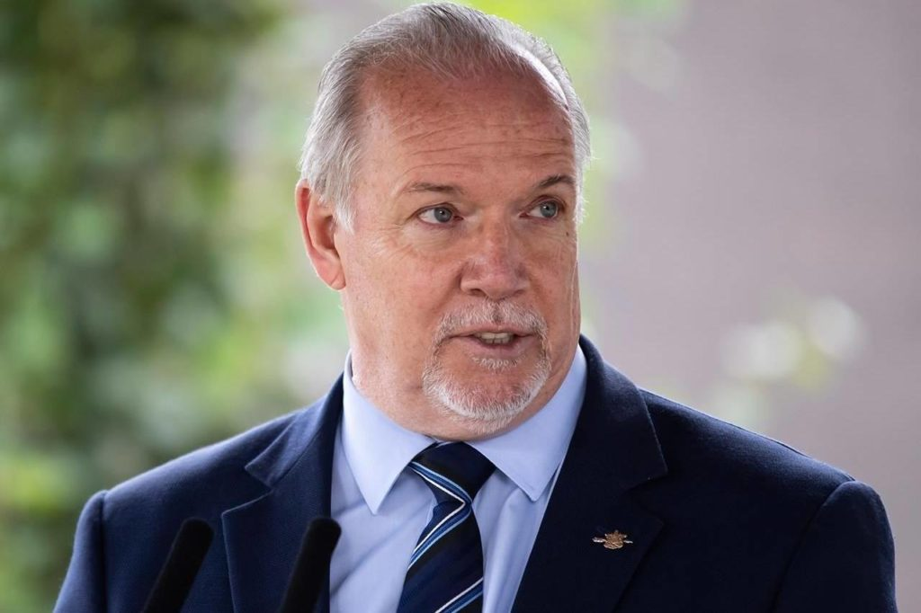 British Columbia Premier John Horgan speaks during an announcement about a new regional cancer centre in Surrey, B.C., on Thursday, Aug. 6, 2020. Horgan is set to introduce his NDP government's new cabinet Thursday. THE CANADIAN PRESS/Darryl Dyck