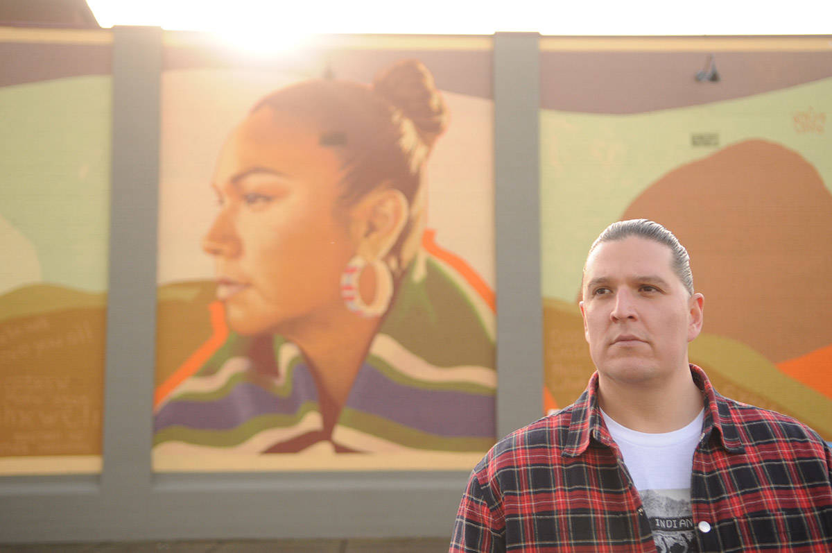 Justin Louis of Chilliwack, seen here on Nov. 21, 2020 beside a mural of his wife Inez Louis, is one of the designers who will be featured on Nov. 26 as part of Indigenous Fashion Week Toronto. (Jenna Hauck/ Chilliwack Progress)