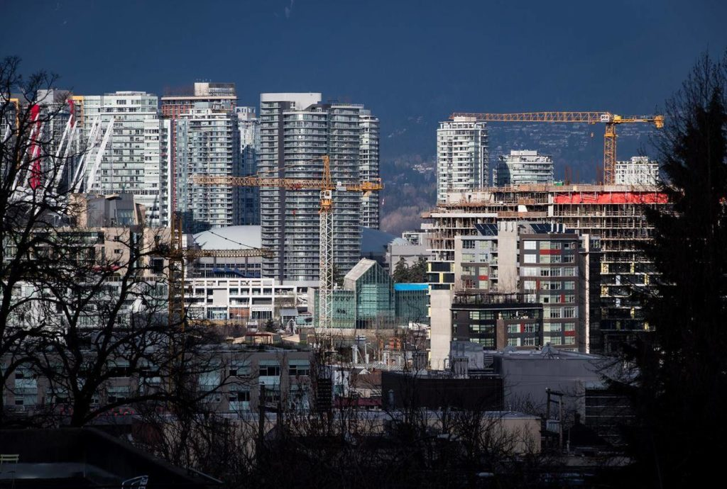 Construction cranes tower above condos under construction near southeast False Creek in Vancouver on February 9, 2020. A study from Canada Mortgage Housing Corp. says over 11,000 condos were added to the housing supply pool in Metro Vancouver last year, spurred in part by taxes on empty homes. THE CANADIAN PRESS/Darryl Dyck