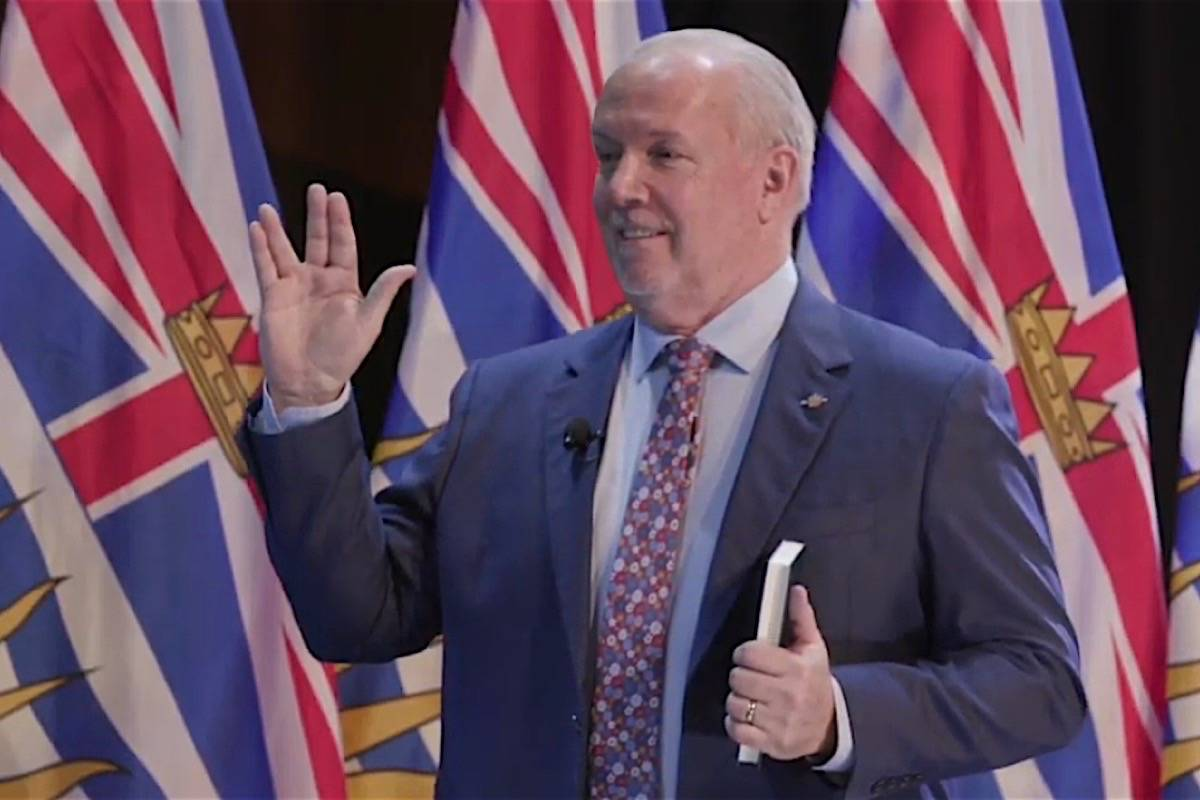 B.C. Premier John Horgan, a Star Trek fan, can't resist a Vulcan salute as he takes the oath of office for a second term in Victoria, Nov. 26, 2020. (B.C. government)