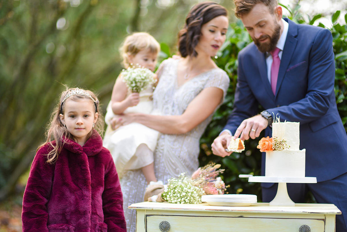 After twice have their wedding plans altered due to COVID-19 restrictions, Suzanne Schmidt and Andrew Sturgess got married in Bakerview Park last weekend, with the only guests being their two daughters, Zoey (foreground) and Tessa. (Darren Ripka photo)