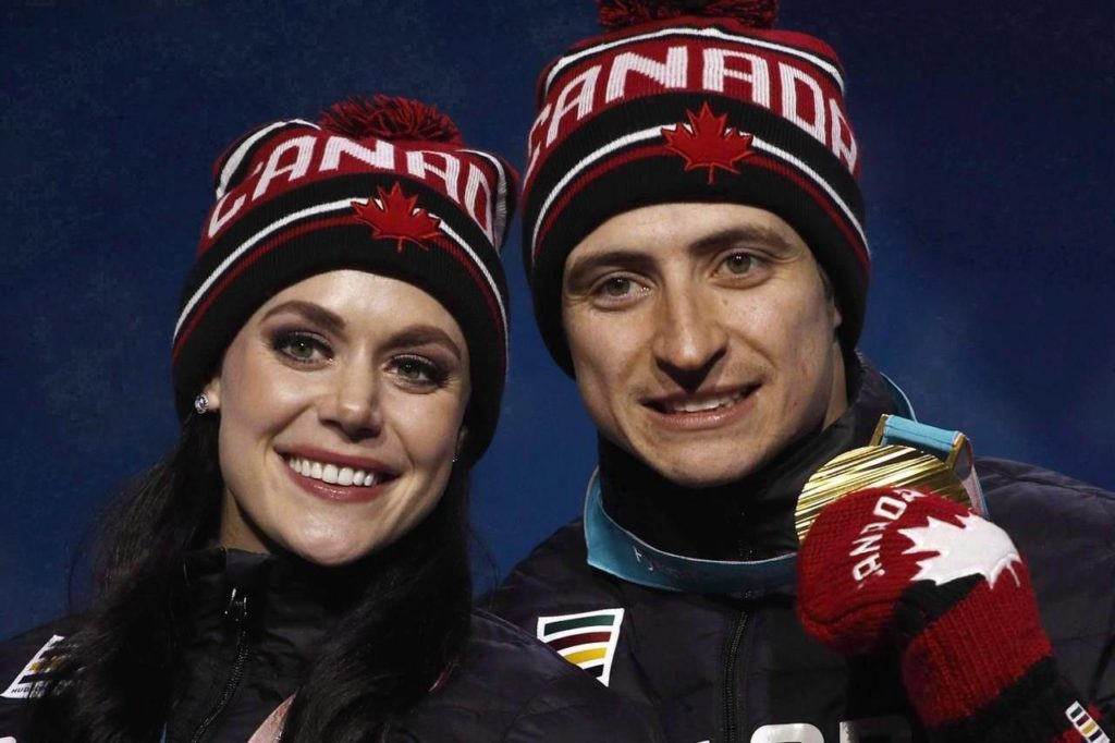 Gold medallists in the ice dance, free dance figure skating Tessa Virtue and Scott Moir, of Canada, pose during their medals ceremony at the 2018 Winter Olympics in Pyeongchang, South Korea, Tuesday, Feb. 20, 2018. THE CANADIAN PRESS/AP-Charlie Riedel