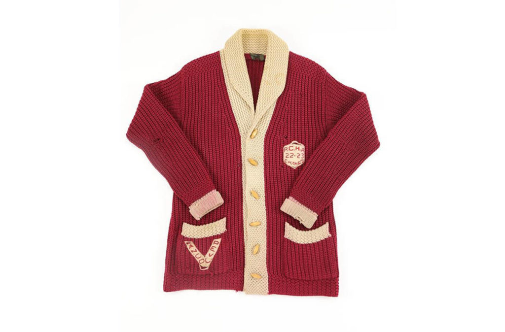 A piece of hockey history is up for sale, with a rare Vancouver Millionaires sweater, seen in an undated handout photo, hitting the auction block. The cream and maroon wool cardigan is believed to have belonged to Hall of Fame goalie Hugh Lehman, who backstopped the Millionaires to a Pacific Coast Hockey Association championship in 1922-23. (Lelands Auction photo)