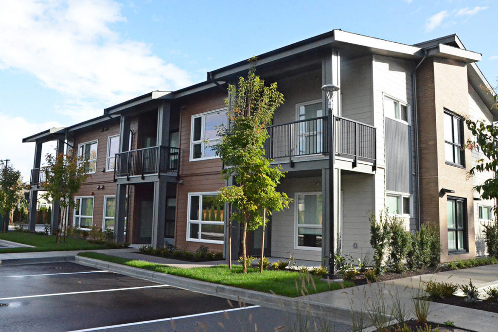 Rents range from $1,000 for a studio apartment up to almost $2,000 for a family townhouse at Emmaus Place, built as affordable housing. (Langley Advance Times files)