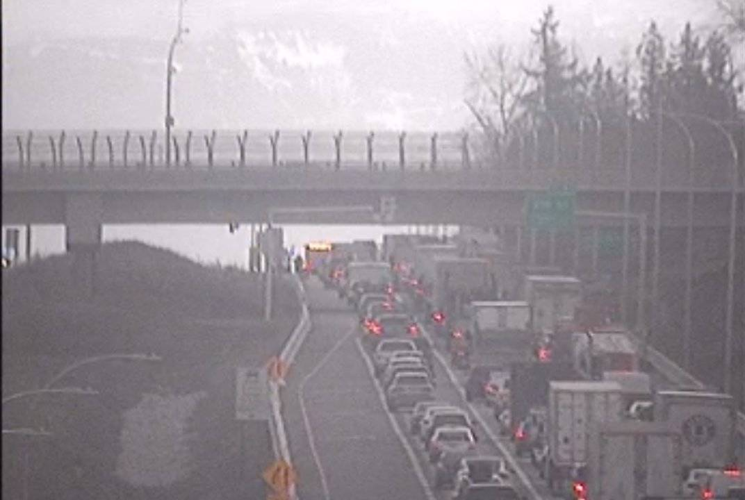 A vehicle incident is blocking all lanes west of 216th Street on the Trans-Canada Highway in Langley on Nov. 27, 2020. Traffic is getting by only on the shoulder. (DriveBC photo)