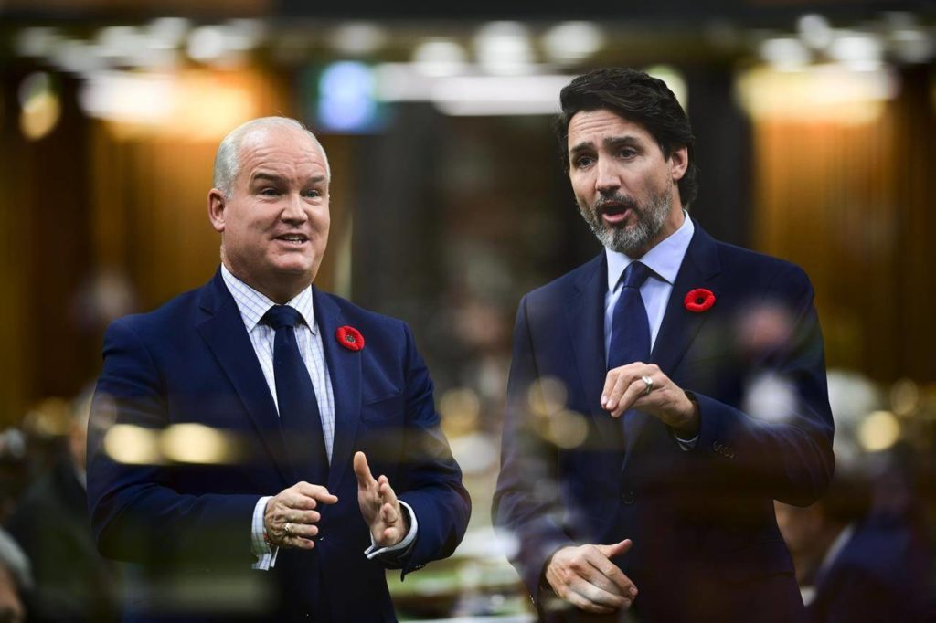 In the multiple-exposed image Conservative Leader Erin O'Toole, left, asks a question and Prime Minister Justin Trudeau answers during question period in the House of Commons on Parliament Hill in Ottawa on Wednesday, Nov. 4, 2020. THE CANADIAN PRESS/Sean Kilpatrick