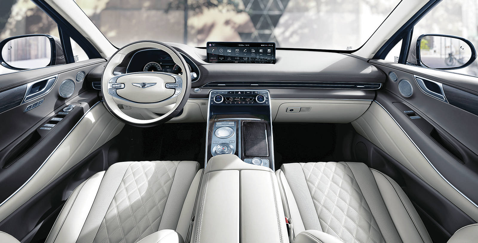 A wide 14.5-inch (diagonal) touch-screen hovers over the sleek and modern centre console, which is home to a dial gear selector for the standard eight-speed automatic transmission. PHOTO: GENESIS