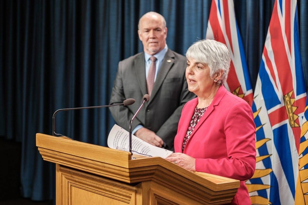 B.C. Finance Minister Carole James and Premier John Horgan announce $5 billion emergency fund for COVID-19 unemployment and other relief, B.C. legislature, March 23, 2020. (B.C. government)