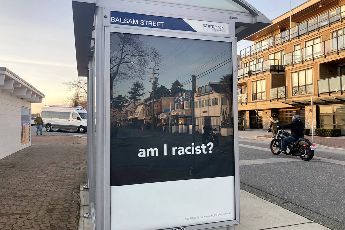 A bus shelter in White Rock is emblazoned with an ad from B.C.'s Office of the Human Rights Commissioner on Sunday, Nov. 29, 2020. (Black Press Media files)