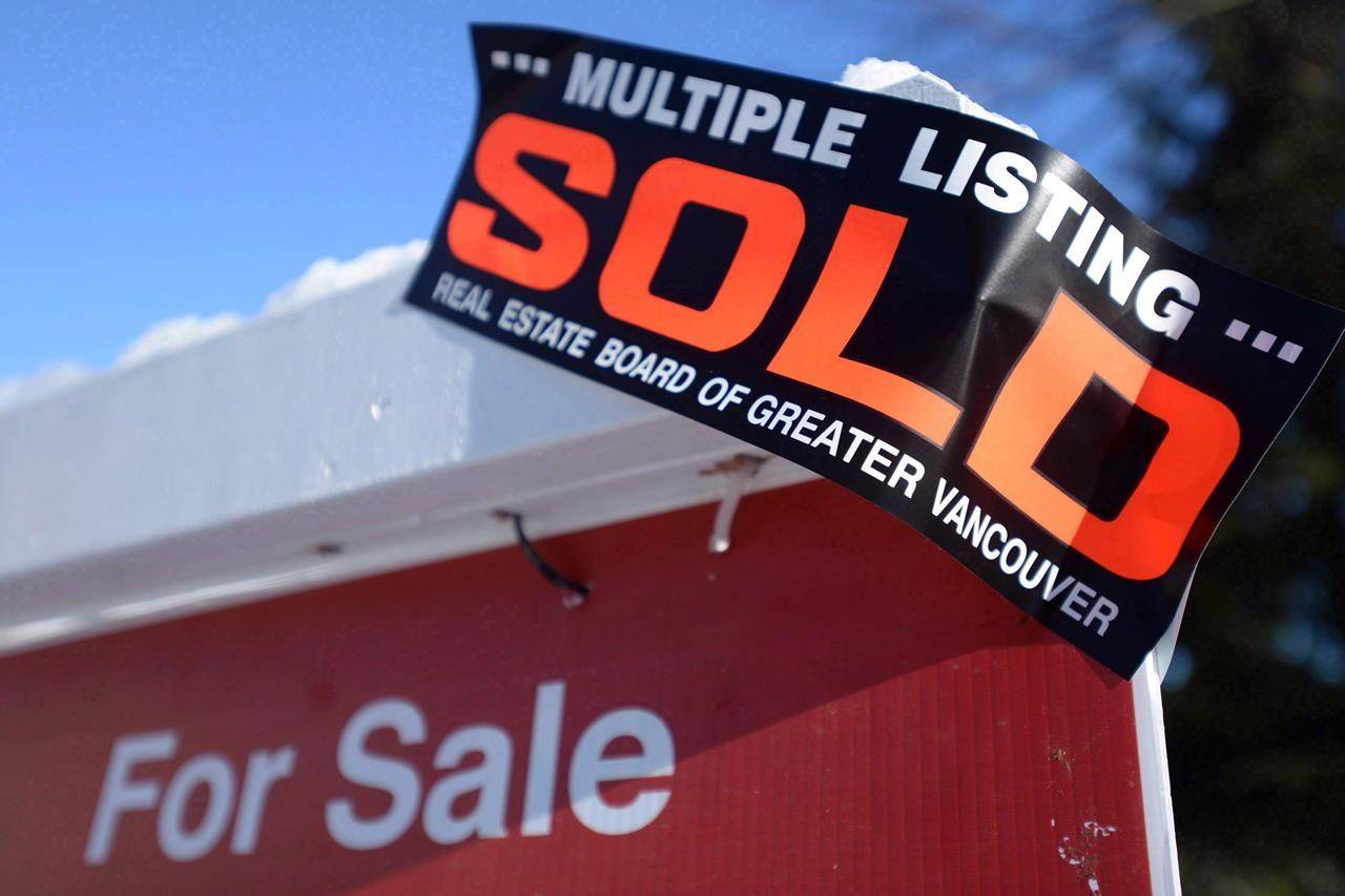 A real estate sold sign is shown outside a house in Vancouver, Tuesday, Jan. 3, 2017. nbsp;Real estate brokerage Royal LePage says home prices are increasing in Canada's cottage country, as more buyers look to move there full-time. THE CANADIAN PRESS/Jonathan Hayward