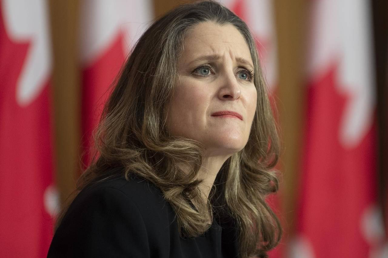 Deputy Prime Minister and Minister of Finance Chrystia Freeland listens to a question from a reporter on the phone during a news conference in Ottawa, Monday, Nov. 30, 2020. THE CANADIAN PRESS/Adrian Wyld