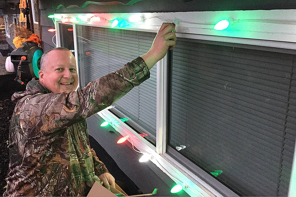Wanting to illuminate his Langley City neighbourhood, 50th Avenue resident Troy Warren, and his wife Debbie, have purchased hundreds of commercial grade Christmas lights for their home and added a number of new features to their front yard holiday exhibit. (Roxanne Hooper/Langley Advance Times)