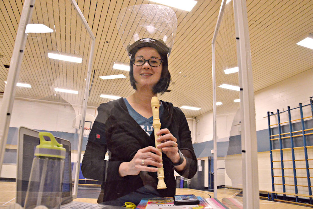A home-made clear shield wraps around her mobile music cart, allowing teacher Kanata Soranaka to provide close up instruction to students while keeping everyone safe. (Heather Colpitts/Langley Advance Times)
