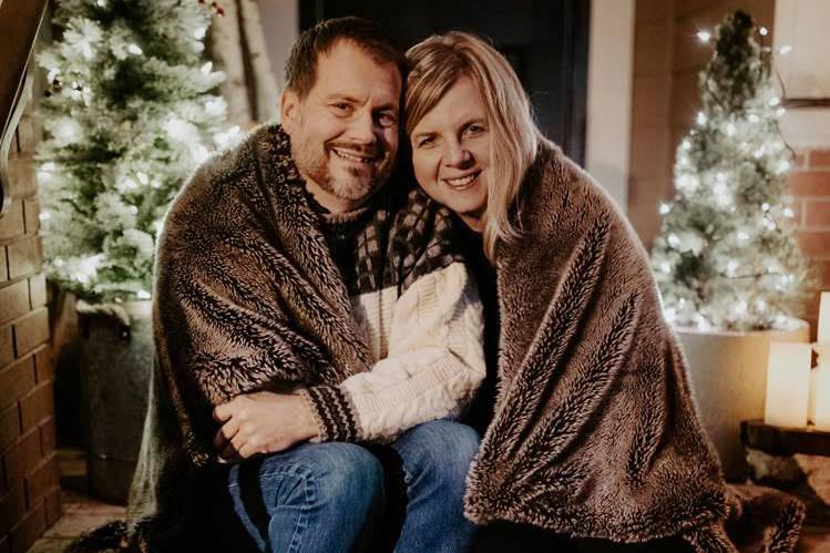 Pastor Derrick and Sara Lee keep warm during last years festivities!