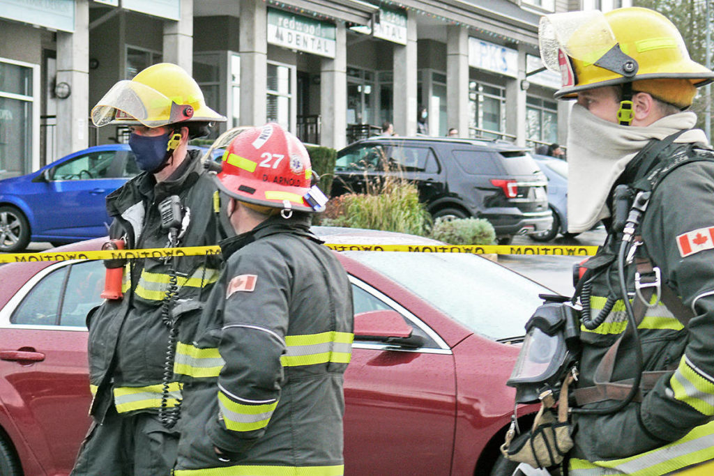 Township of Langley firefighters wore protective masks at a Nov. 17, 2020 call to a burning van incident (Dan Ferguson/Langley Advance Times)