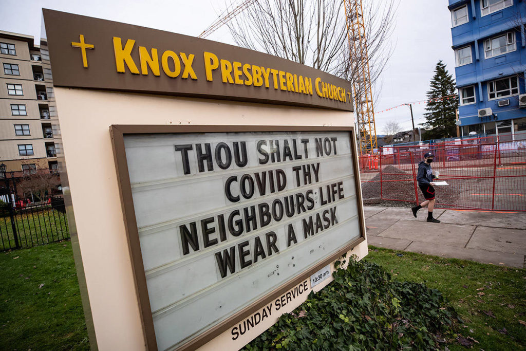 A tongue-in-cheek message about wearing a face mask to curb the spread of COVID-19 on a sign outside a church near Royal Columbia Hospital, in New Westminster, B.C., on Sunday, Nov. 29, 2020. THE CANADIAN PRESS/Darryl Dyck