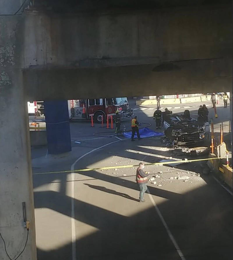 Delta police are investigating after a vehicle drove through a barrier on the ferry ramp and crashed to the ground below at the BC Ferries terminal in Tsawwassen on Tuesday, Dec. 1, 2020. (Chrissybabe1973/Twitter)