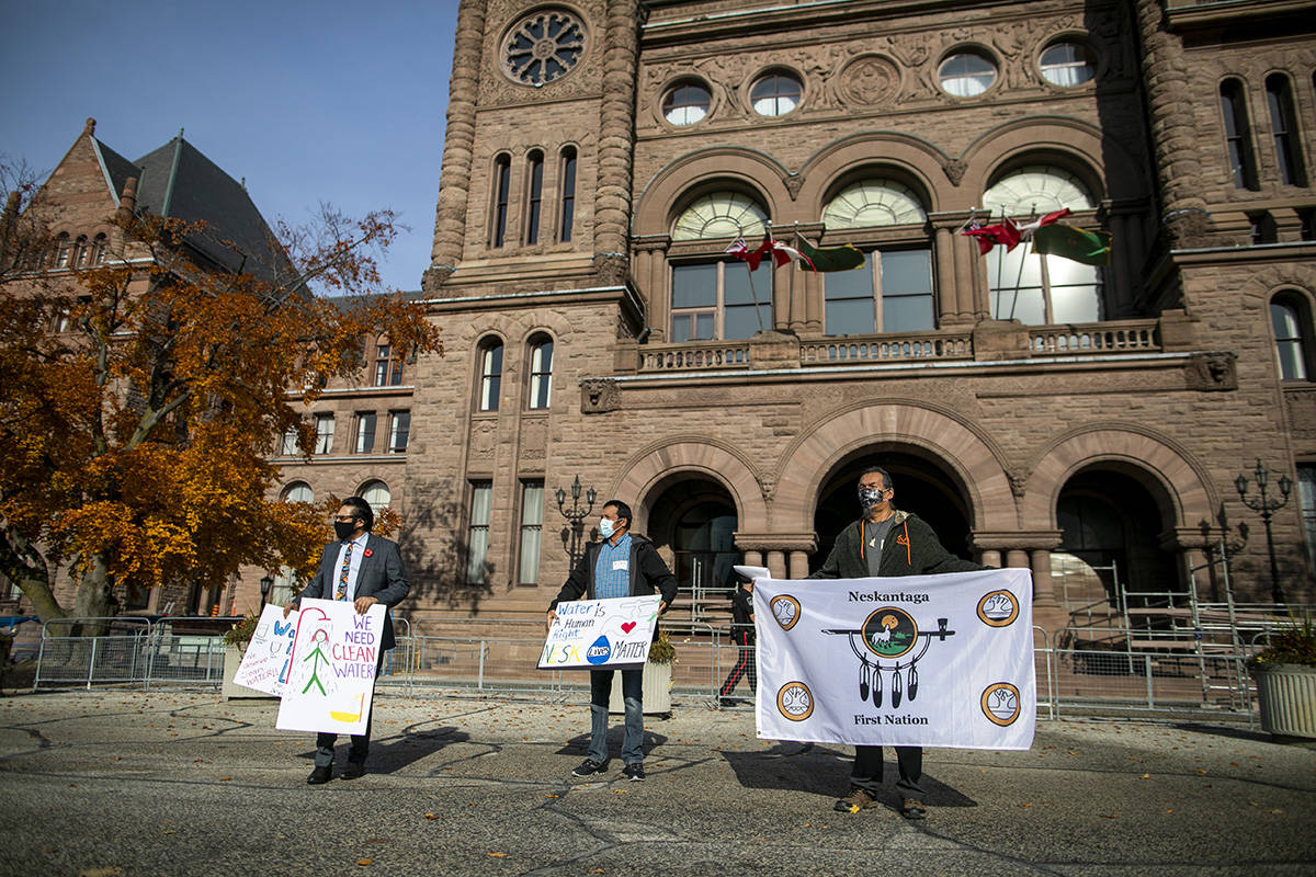 Kiiwetinoong MPP Sol Mamakwa (left to right), Lawrence Sakanee and Alex Moonias of Neskantaga First Nation pose for a photo during a rally outside Queen's Park in Toronto, Friday, Nov.6, 2020. Residents were evacuated over tainted water from the northern Ontario First Nation last month. THE CANADIAN PRESS/Carlos Osorio