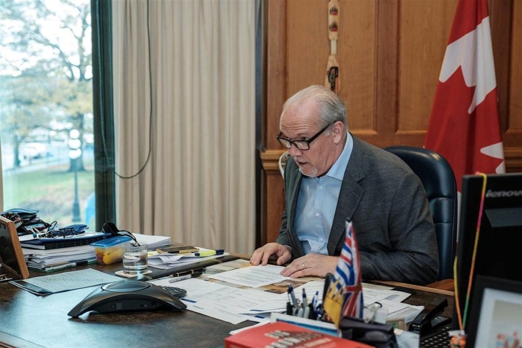 B.C. Premier John Horgan on a conference call with religious leaders from his B.C. legislature office, Nov. 18, 2020, informing them in-person church services are off until further notice. (B.C. government)
